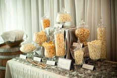 Popcorn Bar- OMG, I love popcorn... this would be a great and probably cheaper alternative to a candy bar for guests