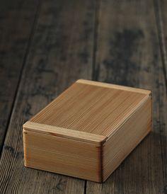 Cedar bento box.  Expensive, but the craftsmanship is sublime.