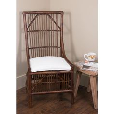 Pairing bistro style with island influences, this rattan side chair showcases an antique brown finish and an upholstered seat.