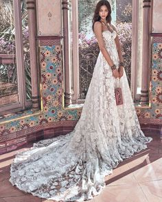 A touch of #romance and admiration to the feminine body. The #Georgia gown made out of a #Victorian rose pattern made of #pearl caviar sequins with #silver accents. #NewCampaign