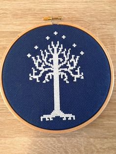 Glow in the Dark White Tree of Gondor Cross stitch.  Perfect unique gift for any Lord of the Rings fan! Stitched with Glow in the Dark thread on