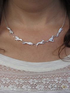 An unique running Sighthounds necklace, designed by Amit Eshel.  This fine necklace contains 6 different dogs in 6 different running