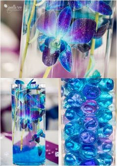 Purple orchids in cylinder vase filled with water as wedding centerpiece…