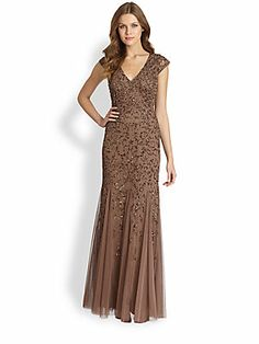 Aidan Mattox Embellished Cap-Sleeve Gown Details This stunning tulle gown showcases degradé filigree embellishment that fades gradually, to reveal an ethereal, floor-length skirt with airy godet insets