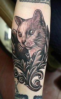 Black & gray cat realistic portrait tattoo with hard black outline by Daniel Chashoudian