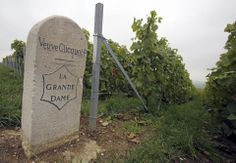 In this Wednesday, Oct. 16, 2013, a stone marker stands at a Veuve Clicquot Ponsardin vineyard in the village of Verzy, near Reims, eastern ...