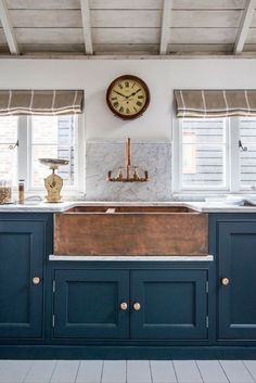 So beautiful! I love the copper with the blue cabinets!