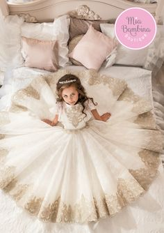 The Chicago flower girl dress is one of our vintage inspired ball gowns. An elegant boat neckline, short flouncy sleeves, and a full gathered tulle skirt create an appealing look. Intricate floral emb