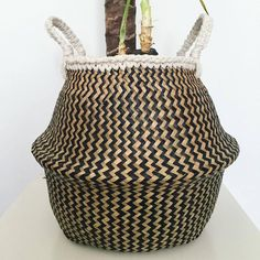 This is a large Seagrass belly basket with black and natural zig zag pattern, macrame handles and a crochet trim. The basket was sourced at a local market and the macrame handles and crochet trim were added by myself using 100% cotton rope. The basket looks great with plants in. As
