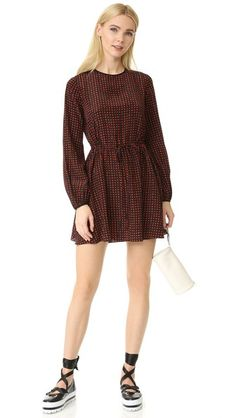 Effortless and charming, this crew neck dress is decorated in our custom Ferma polka dot print. Featuring fluid bell sleeves, a one-button closure in the back, and an adjustable drawstring waist, this is an ideal transitional piece, which is delightfully comfortable too.
