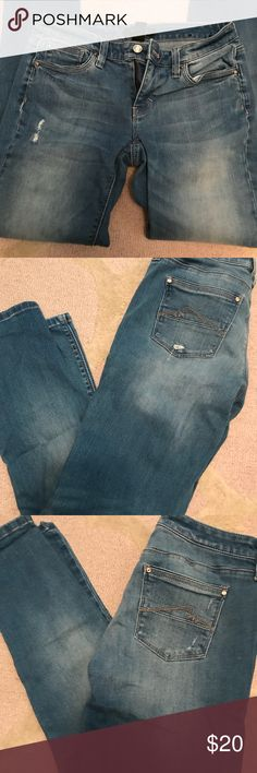 WHBM Distressed Girlfriend Jeans Size 0 distressed lighter wash blue jeans girlfriend cut. Subtle silver thread stitching on pockets front and back with small silver button accents on pockets as well. A quality product. White House Black Market Jeans Straight Leg