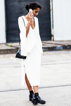 A white Ellery dress is worn with black accessories