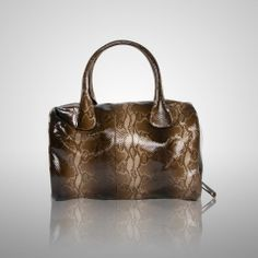 """This is the ultimate luxe overnight satchel available for both women and men. Features double top handles and extra long two-way zippers that allow the bag to open completely. Made of incredibly supple deerskin, this bag will only improve with age. 15""""h x 16""""w $509"""