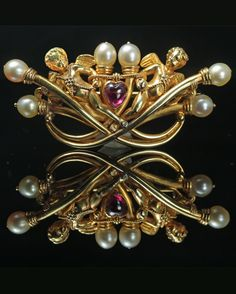 Carlo Giuliano - A Renaissance Revival gold, natural pearl and ruby brooch, about 1880. 4.7 x 2cm. #Giuliano #RenaissanceRevival #antique #brooch