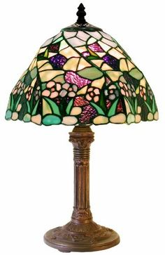 The Tiffany Style 17 in. Lake 1 Light Multicolored Table Lamp has been handcrafted using methods first developed by Louis Comfort Tiffany. The One standard bulb provides illumination and enhances the beauty of each cut glass to your room. Tiffany Lamp Shade, Tiffany Style Table Lamps, Lamp Shade Store, Stained Glass Lamps, Antique Lamps, Cut Glass, Decoration, Lamp Light, Tiffany Glass