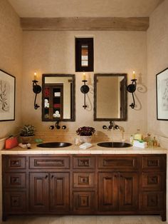 This Mediterranean master bathroom features dual vanity sinks, neutral tiles and rich woods.