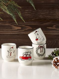 Shiny white porcelain featuring brightly-coloured pine trees, snowmen, bears and pine wreaths for a festive table.