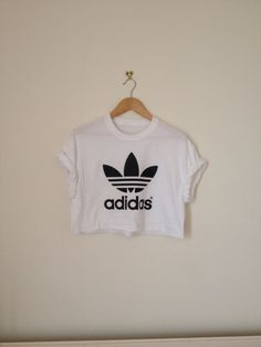you are looking at a very cool dope white classic adidas oversized sloughty crop top tshirt one of a kind, perfect for the festival season