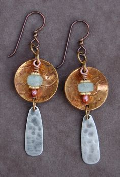 Aquamarine Earrings  A sheet of brass was mill rolled with a piece of fabric to create texture. I then cut, drilled, filed and domed the discs. Dangles were made of faceted aquamarine and vermeil on balled copper wire and hammered silver.