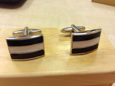 A pair of black n white enamel stainless steel cufflinks.  Priced at $58.  If you purchase this item on dec 26 or 27 you pay only $38.
