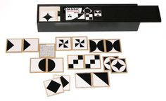 """Legespiel Memo """"Geometrie"""" classic  Memory in klassischem schwarz, weiß mit geometrischen Abbildungen. Ein Legespiel was durch seine Klarheit und hochwertige Verarbeitung überzeugt. 64 Legesteine = 32 Paare aus Birkemultiplex im Siebdruckverfahren bedruckt, mit griffigen abgerundeten Kannten. Ein Klassiker, an dem jeder lange Freude hat.  Material: Lackierte Holzkassette in schwarz, 64 Legesteine bedruckt aus Birkesperrholz Maße: Holzkassette l 38 x b 8,7 x h 6 cm; Legesteine je 6 x 6 ..."""
