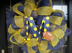 Definitely going to have to make this for my front door! The hubby would LOVE it! Go Blue!