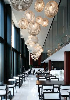 restaurant globe lighting chandelier hotel minimalist design interior architecture. For more hotel inspirations: http://www.delightfull.eu/