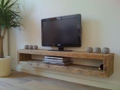 44 Modern TV Stand Designs for Ultimate Home Entertainment Tags: tv stand ideas … - Regal Selber Bauen Floating Tv Stand, Floating Shelves Diy, Floating Tv Console, Floating Shelf Under Tv, Glass Shelves, Floating Tv Unit, Wall Shelves, Diy Shelving, Wooden Console