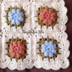 Cute little baby blanket made using granny squares!  https://www.facebook.com/pages/Tangles-for-Tots/440506666150640
