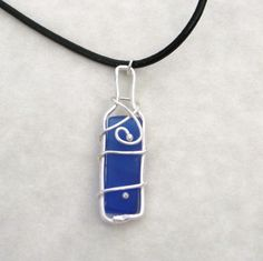 Blue Glass - Recycled wine bottle necklace on leather cord - ICE WINE in BLUE. $30.00, via Etsy.