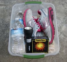 Emergency kits --- Car: blanket, shoes, socks, flashlight, flare + water. --- Pet: towel, food, water + food dish --- Home: duffel bag for travel, shoes, non-perishable food/water for 3 days, radio and batteries, flashlight and batteries, first aid kit, sanitary wipes, toilet paper, towels, matches in container, candles, whistle, flare, all-weather clothes, cooking/kitchen stuff (can opener!), cash, coins, prescriptions, sleeping bags + glasses, contacts + contact solution.