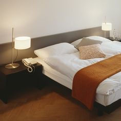 Create a little uniforminty on either side of the bed with the TMD Table Lamp from Santa & Cole. http://www.ylighting.com/blog/perfect-modern-bedroom-lighting/ #YinTheWild