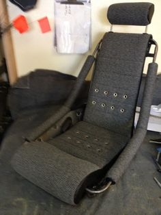 Our 'Hot Rod Zeppelin' seat in tweed with grommet detailing. Classic Car Seats by GTS Classics.