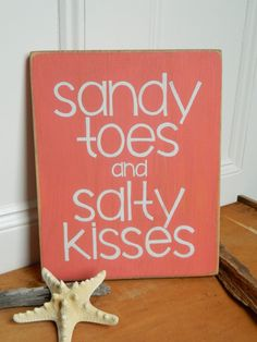 "Coral ""Sandy Toes and Salty Kisses"" hand painted wood beach sign. Yep, that sums it up!"