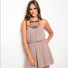 "New  Halter Romper This adorable romper features a tie back halter top, bouncy fit a multicolor top! Super comfy and the perfect outfit for a summer get together!! Length is 33"". Dresses Strapless"