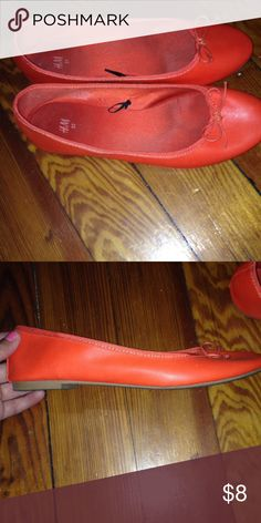 Orange ballet flats Worn a couple of times. The inside of the shoe is a little dirty, but rest of the shoe is in great condition. Shoes Flats & Loafers