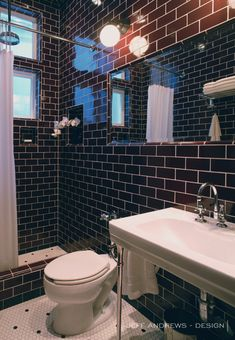 Masculine bathroom with walls tiled in dark brown subway tile highlighted by white grout over white hex tiled floors with black dot accent. Man Bathroom, Bathroom Interior, Kitchen Interior, Modern Bathroom, Bathroom Chrome, Bathroom Ideas, Black Subway Tiles, Black Tiles, Jeff Andrews Design