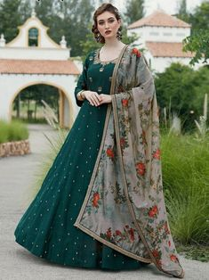 Elegant green embroidered gown online at best shopping price. Shop this latest gown style for diwali celebration. This alluring style set comprises a silk gown with matching chanderi dupatta and crepe bottom.