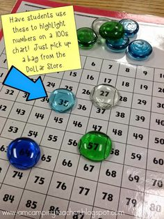 Using clear rocks on 100's charts.  Kids can see the numbers!  Brilliant!