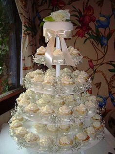 Beauty Adorable Wedding Cake Cupcakes Idea Design in Pretty Accent like the baby's breath but not the cake on top, want giant cupcake.