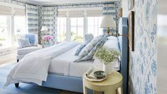 Master Bedroom | Blue and white never looked so brilliant: California designer Mark D. Sikes switched coasts to take on our Idea House in nautical Newport Rhode Island. The result is an East-meets-West-Coast stunner that redefines classic coastal style.