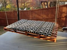 Looks easy, 2 pallets and some outdoor furniture pads. Durable, simple.