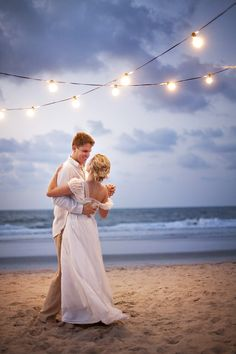 Another AWESOME picture. Wedding photos, beach photography, wedding photography, bride and groom, bistro lights, al fresco