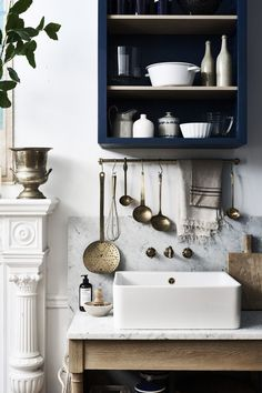 Butchers sink and navy blue shelves
