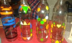 botellas con vinilos coloridas