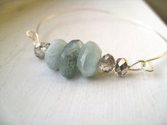 Aquamarine bangle March birthday silver bracelet by Vitrine gift for her. $34.00, via Etsy.