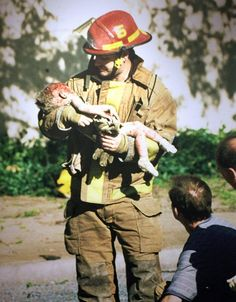 Pulitzer Prize for Spot News Photography 1996: Charles Porter IV, a freelancer - For his haunting photographs, taken after the Oklahoma City bombing and distributed by the Associated Press, showing a one-year-old victim handed to and then cradled by a local fireman.