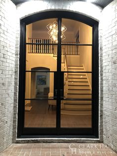 Slim Profile Iron Door showing off beautiful Staircase Entry Doors, Entryway, Clark Hall, Modern Door, Iron Doors, Contemporary Style, Stairs, Windows, Traditional