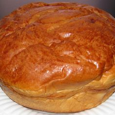 """No where else can make a sweet bread loaf like my hometown of Fall River, MA. It is a traditional recipe that is known to be brought over from the immigrants of São Miguel. This bread is most popular at Easter, but enjoyed year round. I like to have mine for breakfast with a little butter added on it. But, it is also served for dessert. This recipe is adapted from my local paper for """"Easter sweet bread"""". For the holidays, a boiled egg is placed in the center of the loaf. I remember as"""