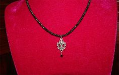 if u like sparkle this u will love this black sparkle bead necklace with Fleur De Lis pendant with black cyrstal drop